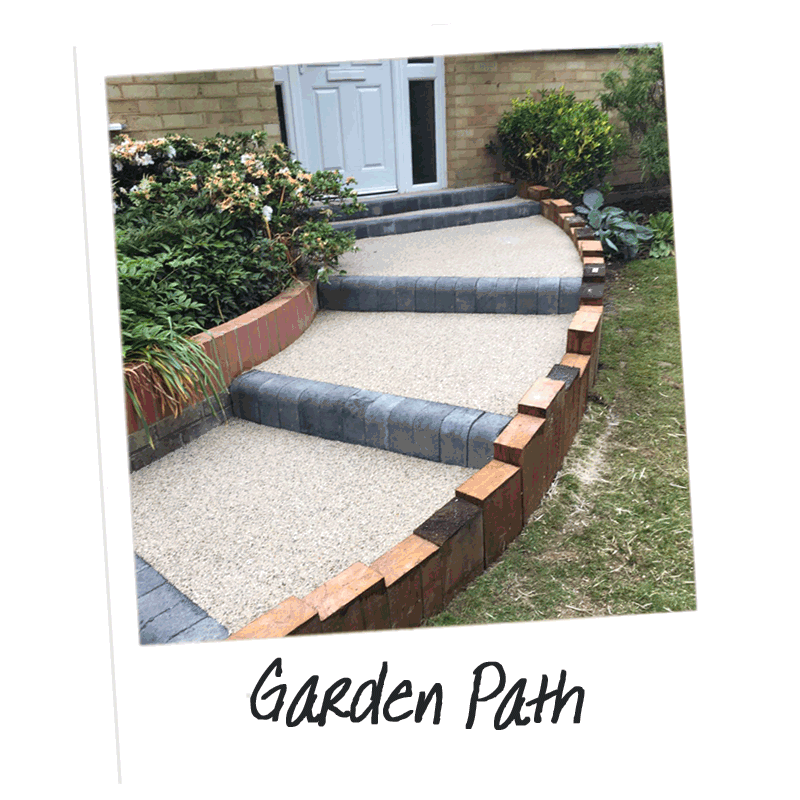 An example of a resin path leading to the front door with bull nose blocks and an upright sleeper retaining wall
