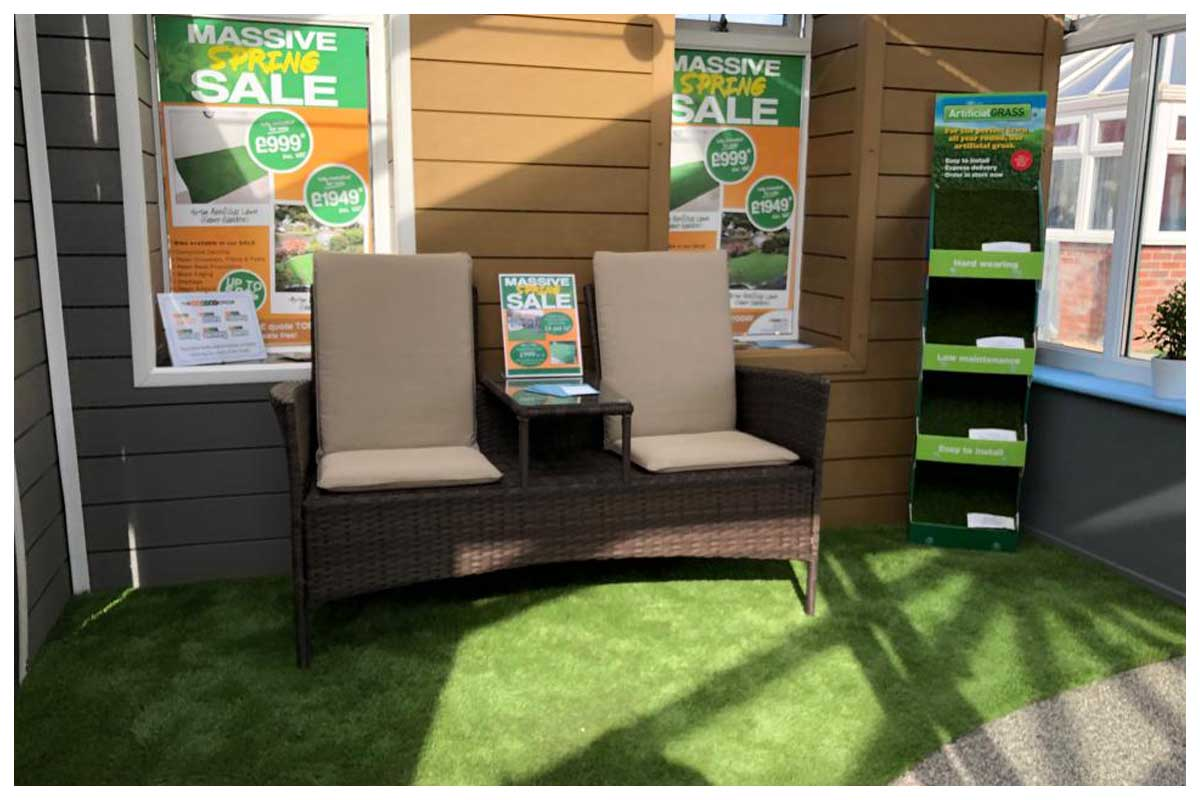 Composite cladding alongside our artificial grass samples with an artificial lawn floor to walk on.
