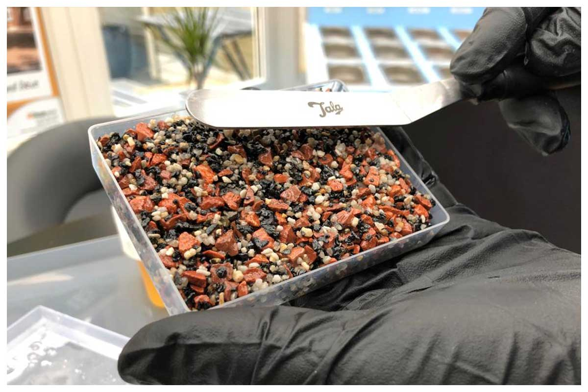 Trowel the resin bound aggregate blend flat